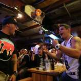 Ruben Hernandez, left, and Luke Villalpando celebrate after a point by the Spurs during Game 5 of the NBA Finals on Sunday, June 15, 2014, at Fatso's Sports Garden in San Antonio. General manager Jim Woods estimated about 500 customers were present to watch the game.