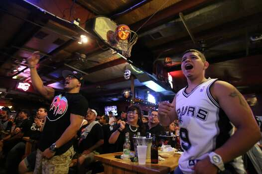 Ruben Hernandez, left, and Luke Villalpando react to a call during Game 5 of the NBA Finals on Sunday, June 15, 2014, at Fatso's Sports Garden in San Antonio. General manager Jim Woods estimated about 500 customers were present to watch the game. Photo: Timothy Tai, Express-News Staff / © 2014 San Antonio Express-News
