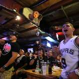 Ruben Hernandez, left, and Luke Villalpando react to a call during Game 5 of the NBA Finals on Sunday, June 15, 2014, at Fatso's Sports Garden in San Antonio. General manager Jim Woods estimated about 500 customers were present to watch the game.