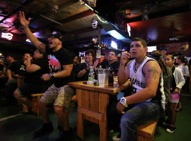 Ruben Hernandez, left, and Luke Villalpando watch Game 5 of the NBA Finals on Sunday, June 15, 2014, at Fatso's Sports Garden in San Antonio. General manager Jim Woods estimated about 500 customers were present to watch the game. Photo: Timothy Tai, Express-News Staff / © 2014 San Antonio Express-News