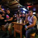 Ruben Hernandez, left, and Luke Villalpando watch Game 5 of the NBA Finals on Sunday, June 15, 2014, at Fatso's Sports Garden in San Antonio. General manager Jim Woods estimated about 500 customers were present to watch the game.
