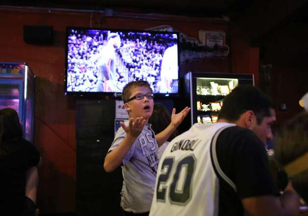 John Arredondo, 12, reacts to a call during Game 5 of the NBA Finals on Sunday, June 15, 2014, at Fatso's Sports Garden in San Antonio. General manager Jim Woods estimated about 500 customers were present to watch the game. Photo: Timothy Tai, Express-News Staff / © 2014 San Antonio Express-News
