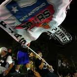 Fans celebrate in downtown San Antonio on Sunday, June 15, 2014, after the Spurs defeated the Miami Heat to win the NBA Championship.