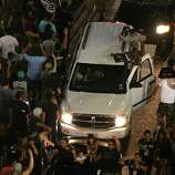 Fans celebrate on W. Commerce Street between N. Presa Street and S. Alamo Street on Sunday, June 15, 2014, after the Spurs won the NBA Championship.