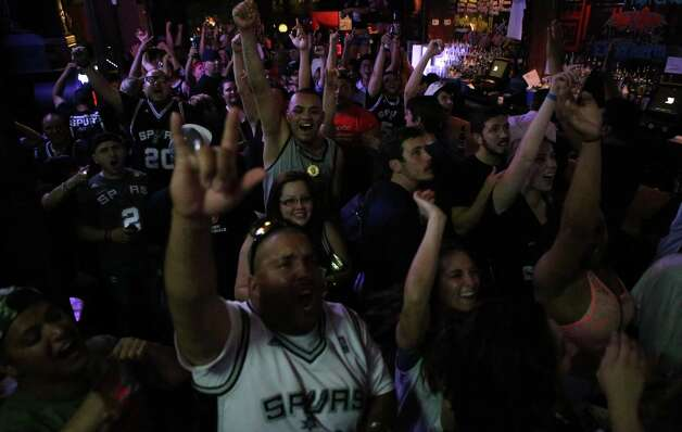 Spurs fans cheer while watching Game 5 of the NBA Finals on Sunday, June 15, 2014, at Coyote Ugly Saloon in San Antonio. Photo: Timothy Tai, Express-News Staff / © 2014 San Antonio Express-News