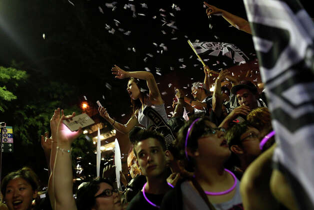 Fans celebrate the Spurs winning the NBA Championship after beating the Miami Heat on Commerce Street in downtown San Antonio on Sunday, June 15, 2014 Photo: Lisa Krantz, Express-News Staff / SAN ANTONIO EXPRESS-NEWS