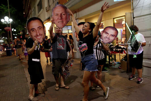 Fans celebrate the Spurs winning the NBA Championship after beating the Miami Heat in downtown San Antonio on Sunday, June 15, 2014. Photo: Lisa Krantz, Express-News Staff / SAN ANTONIO EXPRESS-NEWS