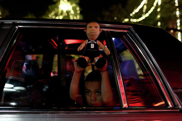 Davian Aguilar, 4, celebrates the Spurs winning the NBA Championship after beating the Miami Heat in downtown San Antonio on Sunday, June 15, 2014. Photo: Lisa Krantz, Express-News Staff / SAN ANTONIO EXPRESS-NEWS