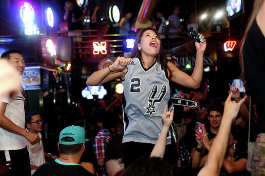 Victoria Ritchie celebrates the Spurs winning the NBA Championship after beating the Miami Heat in downtown San Antonio on Sunday, June 15, 2014. Photo: Lisa Krantz, Express-News Staff / SAN ANTONIO EXPRESS-NEWS