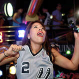 Victoria Ritchie celebrates the Spurs winning the NBA Championship after beating the Miami Heat in downtown San Antonio on Sunday, June 15, 2014.