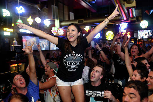 Melissa Riojas celebrates the Spurs winning the NBA Championship after beating the Miami Heat at Ticket Sports Pub in downtown San Antonio on Sunday, June 15, 2014. Photo: Lisa Krantz, Express-News Staff / SAN ANTONIO EXPRESS-NEWS