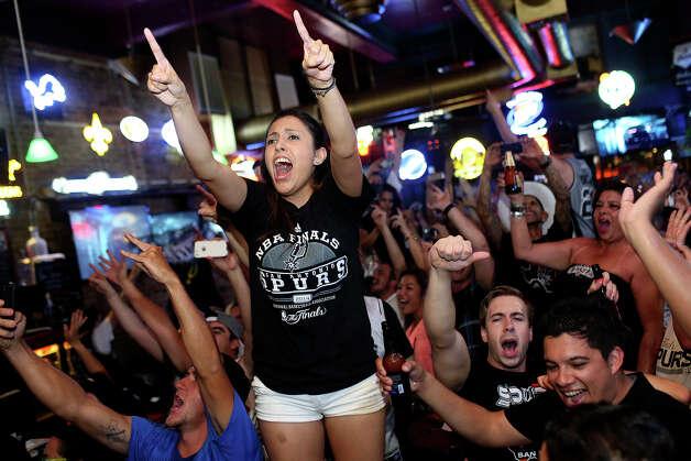 Melissa Riojas celebrates the Spurs winning the NBA Championship after beating the Miami Heat at Ticket Sports Pub in downtown San Antonio on Sunday, June 15, 2014. Photo: Lisa Krantz, Express-News Staff / SAN ANTONIO EXPRESS-NEWS
