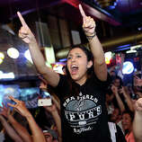Melissa Riojas celebrates the Spurs winning the NBA Championship after beating the Miami Heat at Ticket Sports Pub in downtown San Antonio on Sunday, June 15, 2014.