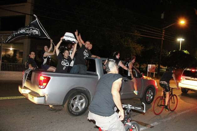 Fans carouse through the streets following the Spurs' winning of the NBA Finals. Photo: By Jacob Beltran, Express-News