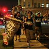 Fans carouse through the streets following the Spurs' winning of the NBA Finals.