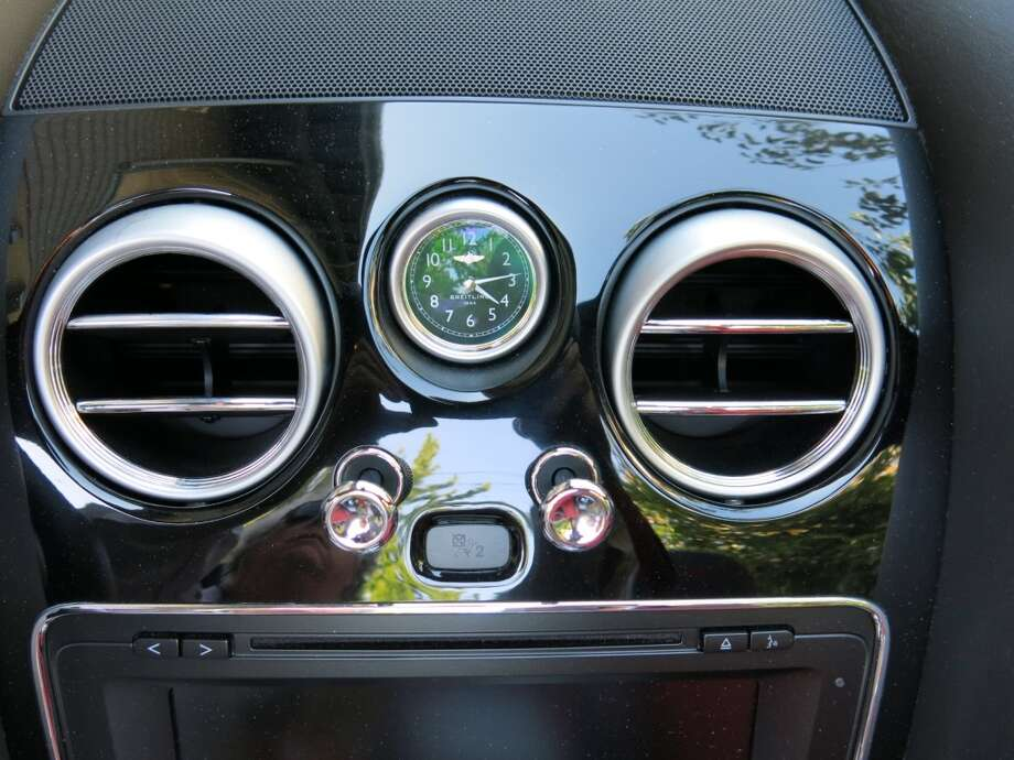 The traditional blower vents and push-pull knobs take you back a few years in Bentley-dom.
