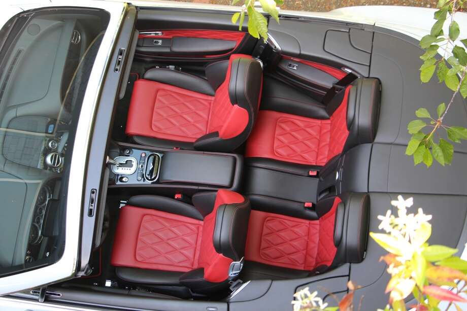 The rear seats offer almost no leg room, but they're pretty.