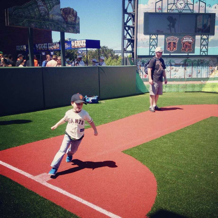 Julie Root Wilcox  posted a picture of the joy of the first time running the bases at AT&T Park. Photo: Julie Root Wilcox , Courtesy