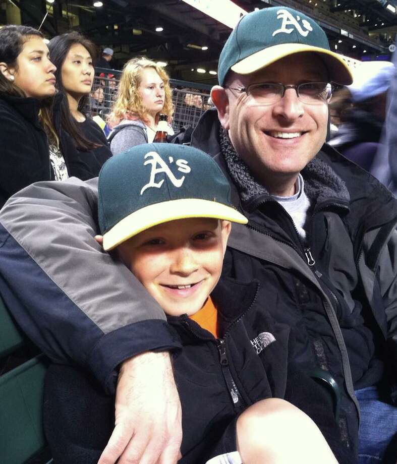 "Leilah Gilligan sent us a photo of ""Dad and son at A's vs. Giants."" Photo: Leilah Gilligan, Courtesy"