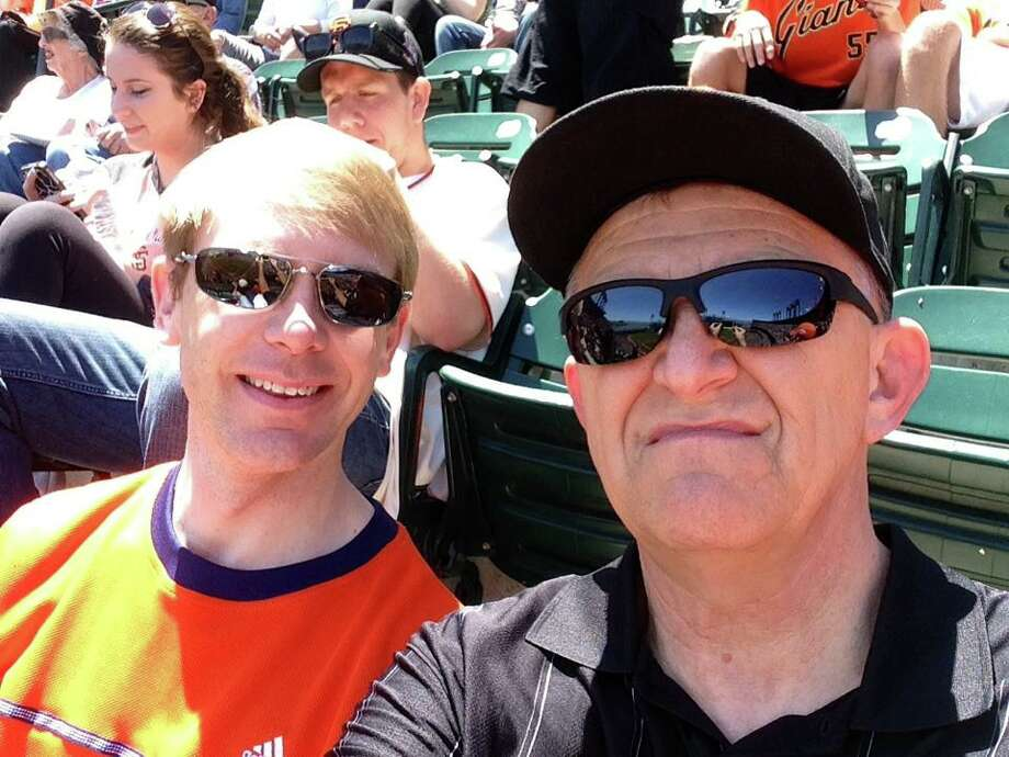 "Reader Eric Willett  captioned this photo: ""My Father and I at AT&T Park on my Birthday this past May 18th. The Giants beat the Marlins 4-1."" Photo: Eric Willett , Courtesy"