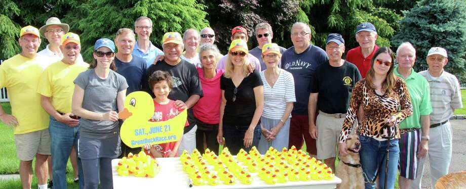 "Members of the Westport Sunrise Rotary Club have been prepping thousands of rubber ducks to compete Saturday in the club's ""Great Duck Race"" on the Saugatuck River. Find out more.  Photo: Contributed Photo / Westport News"