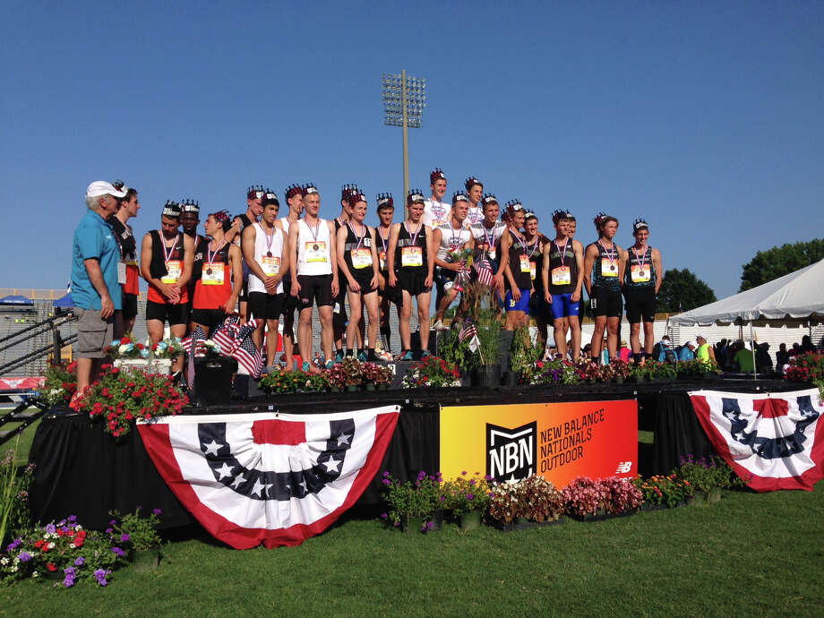 Members of the Darien boys Distance Medley Relay team, including Alex Ostberg, Armstrong Noonan, Arthur Cassidy and Carter Ashcraft stand center in black after taking second place at the 2014 New Balance Outdoor Nationals in Greensboro, N.C. on Sunday, June 15. Photo: Contributed / Darien News Contributed