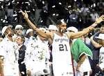 San Antonio Spurs' Kawhi Leonard, Tim Duncan and teammates react after Game 5 of the 2014 NBA Finals against the Miami Heat Sunday June 15, 2014 at the AT&T Center. The Spurs won 104-87.