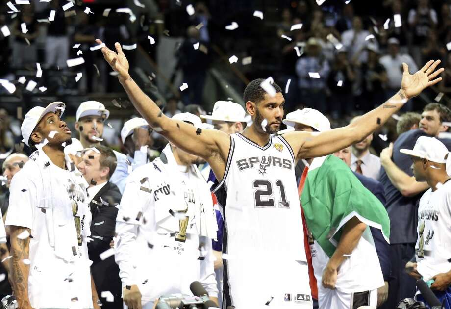 San Antonio Spurs' Kawhi Leonard, Tim Duncan and teammates react after Game 5 of the 2014 NBA Finals against the Miami Heat Sunday June 15, 2014 at the AT&T Center. The Spurs won 104-87. Photo: Edward A. Ornelas, San Antonio Express-News