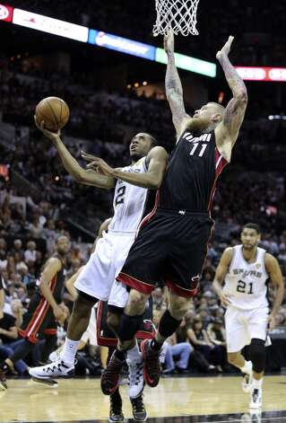 San Antonio Spurs' Kawhi Leonard goes for the layup past Miami Heat's Chris Andersen during second half action in Game 5 of the 2014 NBA Finals Sunday June 15, 2014 at the AT&T Center. Photo: Edward A. Ornelas, San Antonio Express-News
