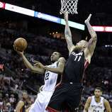 San Antonio Spurs' Kawhi Leonard goes for the layup past Miami Heat's Chris Andersen during second half action in Game 5 of the 2014 NBA Finals Sunday June 15, 2014 at the AT&T Center.