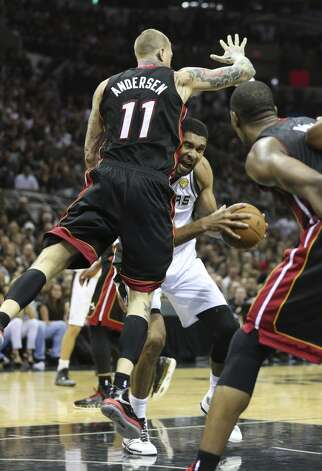 San Antonio Spurs' Tim Duncan gets fouled by Miami Heat's Chris Andersen during second half action in Game 5 of the 2014 NBA Finals Sunday June 15, 2014 at the AT&T Center. Photo: Edward A. Ornelas, San Antonio Express-News