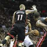 San Antonio Spurs' Tim Duncan gets fouled by Miami Heat's Chris Andersen during second half action in Game 5 of the 2014 NBA Finals Sunday June 15, 2014 at the AT&T Center.