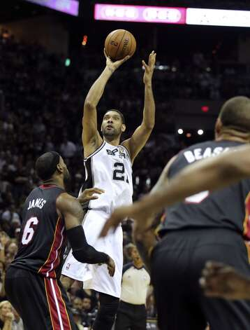 San Antonio Spurs' Tim Duncan takes a jump shot during second half action in Game 5 of the 2014 NBA Finals Sunday June 15, 2014 at the AT&T Center. Photo: Edward A. Ornelas, San Antonio Express-News