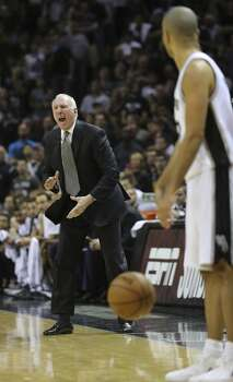 Spurs head coach Gregg Popovich motivates his team during second half action in Game 5 of the 2014 NBA Finals Sunday June 15, 2014 at the AT&T Center. Photo: Edward A. Ornelas, San Antonio Express-News