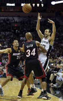 San Antonio Spurs' Manu Ginobili gets pinned along the sideline by Miami Heat's Shane Battier and Miami Heat's Ray Allen during first half action in Game 5 of the 2014 NBA Finals Sunday June 15, 2014 at the AT&T Center. Photo: Edward A. Ornelas, San Antonio Express-News