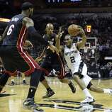San Antonio Spurs' Kawhi Leonard drives towards the basket around Miami Heat's LeBron James and Ray Allen  during first half action in Game 5 of the 2014 NBA Finals Sunday June 15, 2014 at the AT&T Center.