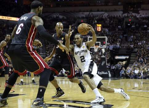 San Antonio Spurs' Kawhi Leonard drives towards teh basket during first half action in Game 5 of the 2014 NBA Finals Sunday June 15, 2014 at the AT&T Center. Photo: Edward A. Ornelas, San Antonio Express-News