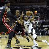 San Antonio Spurs' Kawhi Leonard drives towards teh basket during first half action in Game 5 of the 2014 NBA Finals Sunday June 15, 2014 at the AT&T Center.