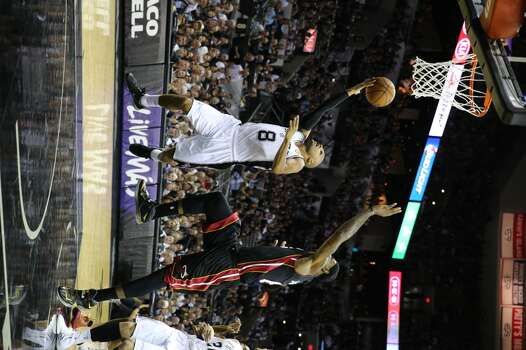 San Antonio Spurs' Patty Mills goes for the layup past Miami Heat's LeBron James during first half action in Game 5 of the 2014 NBA Finals Sunday June 15, 2014 at the AT&T Center. Photo: Edward A. Ornelas, San Antonio Express-News
