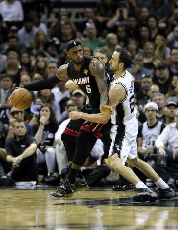 Miami Heat's LeBron James tries to muscle his way past San Antonio Spurs' Manu Ginobili during first half action in Game 5 of the 2014 NBA Finals Sunday June 15, 2014 at the AT&T Center. Photo: Edward A. Ornelas, San Antonio Express-News