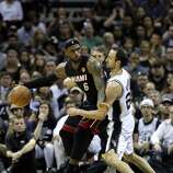 Miami Heat's LeBron James tries to muscle his way past San Antonio Spurs' Manu Ginobili during first half action in Game 5 of the 2014 NBA Finals Sunday June 15, 2014 at the AT&T Center.