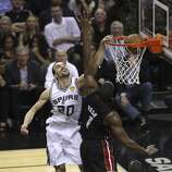 San Antonio Spurs' Manu Ginobili dunks over Miami Heat's Chris Bosh in the second quarter of Game 5 of the 2014 NBA Finals at the AT&T Center on Sunday, June 15, 2014. (Kin Man Hui/San Antonio Express-News)