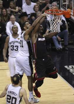 San Antonio Spurs' Tim Duncan draws the foul on Miami Heat's Chris Bosh in the second  halfof Game 5 of the 2014 NBA Finals at the AT&T Center on Sunday, June 15, 2014. (Kin Man Hui/San Antonio Express-News) Photo: Kin Man Hui, San Antonio Express-News