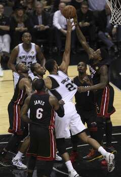 San Antonio Spurs' Tim Duncan takes a contested shot against Miami Heat's Udonis Haslem in the second quarter of Game 5 of the 2014 NBA Finals at the AT&T Center on Sunday, June 15, 2014. (Kin Man Hui/San Antonio Express-News) Photo: Kin Man Hui, San Antonio Express-News