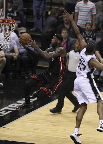 Miami Heat's LeBron James goes for shot against San Antonio Spurs' Boris Diaw in the first quarter of Game 5 of the 2014 NBA Finals at the AT&T Center on Sunday, June 15, 2014. (Kin Man Hui/San Antonio Express-News) Photo: Kin Man Hui, San Antonio Express-News