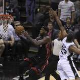 Miami Heat's LeBron James goes for shot against San Antonio Spurs' Boris Diaw in the first quarter of Game 5 of the 2014 NBA Finals at the AT&T Center on Sunday, June 15, 2014. (Kin Man Hui/San Antonio Express-News)