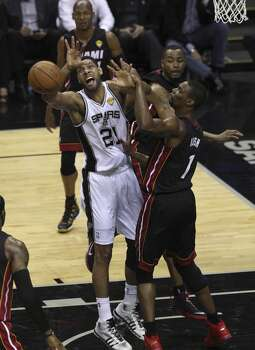 San Antonio Spurs' Tim Duncan gets a shot blocked by Miami Heat's Chris Bosh in the first quarter of Game 5 of the 2014 NBA Finals at the AT&T Center on Sunday, June 15, 2014. (Kin Man Hui/San Antonio Express-News) Photo: Kin Man Hui, San Antonio Express-News