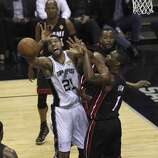 San Antonio Spurs' Tim Duncan gets a shot blocked by Miami Heat's Chris Bosh in the first quarter of Game 5 of the 2014 NBA Finals at the AT&T Center on Sunday, June 15, 2014. (Kin Man Hui/San Antonio Express-News)