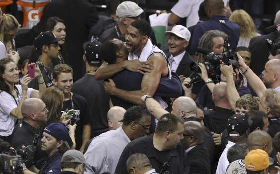 San Antonio Spurs' Tim Duncan gives a hug to former Spurs David Robinson after the Spurs' defeated the Miami Heat in Game 5 of the 2014 NBA Finals at the AT&T Center on Sunday, June 15, 2014. (Kin Man Hui/San Antonio Express-News) Photo: Kin Man Hui, San Antonio Express-News