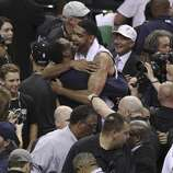 San Antonio Spurs' Tim Duncan gives a hug to former Spurs David Robinson after the Spurs' defeated the Miami Heat in Game 5 of the 2014 NBA Finals at the AT&T Center on Sunday, June 15, 2014. (Kin Man Hui/San Antonio Express-News)